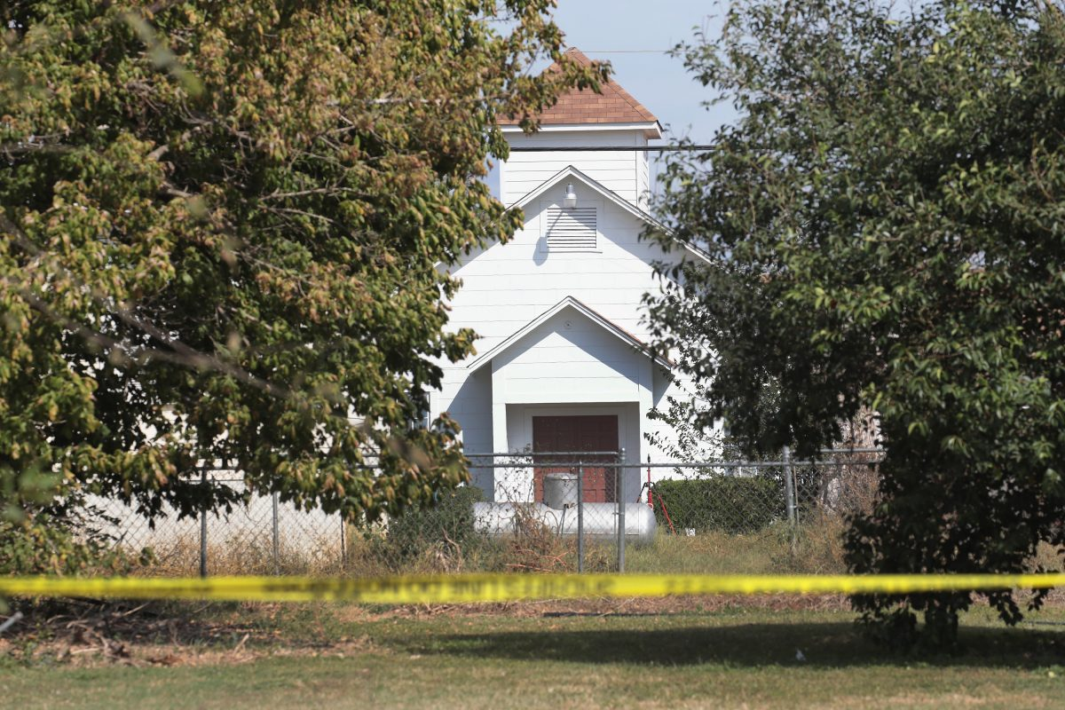 Crime scene tape remains stretched along a road near the First Baptist Church of Sutherland Springs on November 7, 2017 in Sutherland Springs, Texas. (Scott Olson/Getty Images)