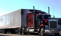 Teen Hitches a Ride on a Semi-Trailer