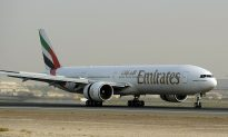 Emirates Flight Attendant Dies After Falling Out of Plane