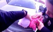 Bodycam Footage Shows Officers Racing to Save Choking Infant