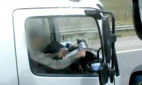 Shocking Footage Shows Truck Driver Writing on Notepad While Driving at Speed