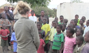 These african children have never heard folk music, but when she does—just watch how they react