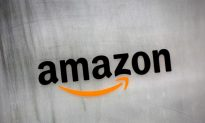 Prime Hike Gives Amazon Warchest for Fight Over Postal Costs