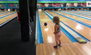 3-year-old throws bowling ball down the lane. But what she hits—she's a natural