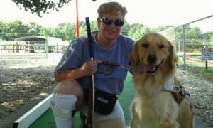 Blind woman uses chance to test special glasses to see her guide dog for first time ever