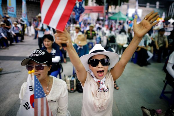 Members of a conservative civic group attend an anti-North Korea and pro-U.S. protest in Seoul, South Korea, Aug. 4, 2018