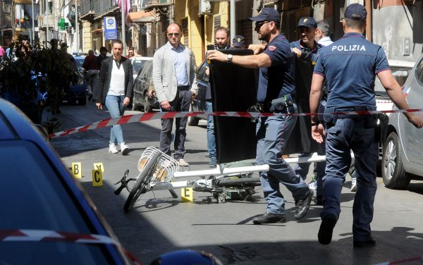 Italian police work on the site where mafia boss Giuseppe Dainotti, 67, was gunned down by two killers while riding his bike police said, on May 22, 2017 in Via d'Ossuna in Palermo, Sicily. (ALESSANDRO FUCARINI/AFP/Getty Images)