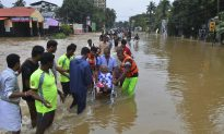 People Plucked From Rooftops as Indian Floods Kill 324